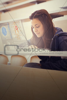 Focused college student working on her digital laptop