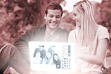 Cheerful young couple watching photos together on digital interface