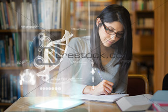 Focused mature student studying medicine on digital interface