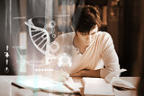 Concentrated college student analysing dna on digital interface