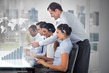 Call center employees at work on futuristic interfaces showing map and graph
