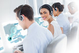 Pretty call center worker using futuristic interface hologram