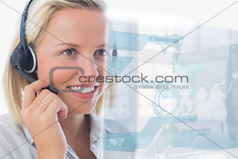 Blonde call center worker using futuristic holographic interface