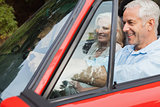 Happy mature man having a ride with his wife