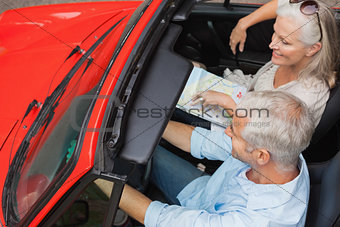 Smiling mature man having a ride with his wife
