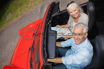 High angle view of smiling mature man having a ride with his wife