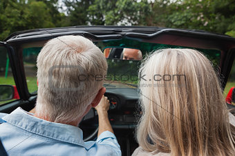 Rear view of mature couple going for a ride together