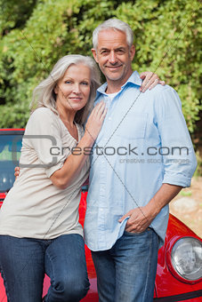 Smiling mature couple posing
