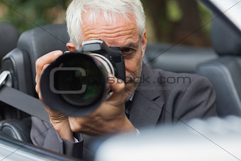 Paparazzi taking picture with his professional camera