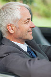 Relaxed businessman driving cabriolet