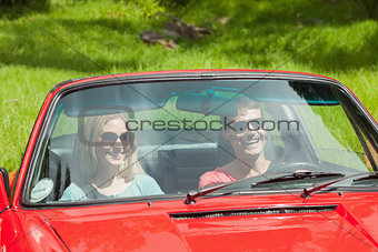 Happy young couple going for a ride together