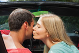 Attractive blonde kissing her boyfriend