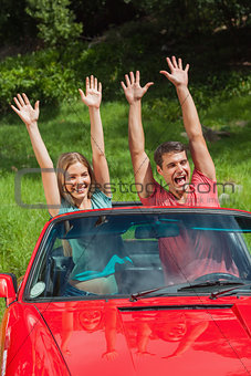 Crazy couple having fun in their cabriolet