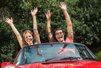 Happy couple having fun in their cabriolet