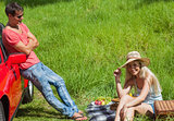 Happy couple having picnic together