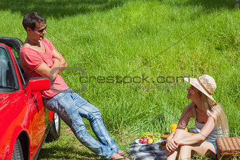 Cheerful couple having picnic together