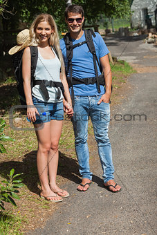 Happy couple going for a trek together