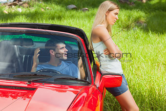 Young couple having a dispute while going on holidays