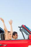 Joyful couple going on holidays together