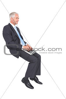 Confident mature businessman working on his laptop