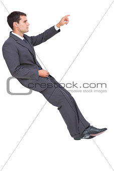 Businessman sitting and pointing the finger