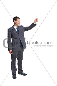 Smiling businessman holding something up in the air