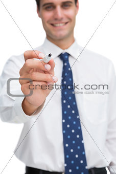 Smiling businessman holding marker