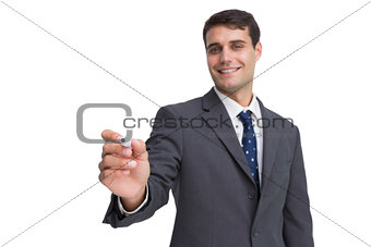 Smiling businessman holding marker and looking at camera