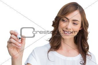 Attractive businesswoman holding marker