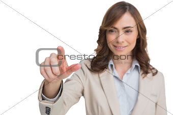 Portrait of businesswoman pointing her finger at camera