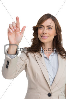 Young businesswoman touching invisible screen