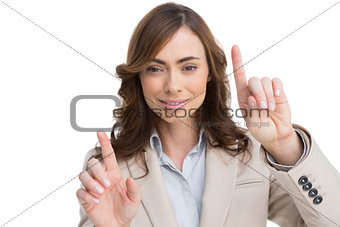 Classy businesswoman touching invisible screen
