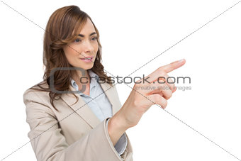 Businesswoman pressing an invisible key
