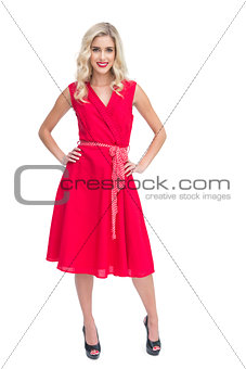 Blonde woman wearing red dress