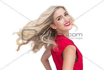 Smiling glamorous blonde posing