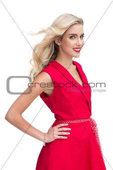Beautiful woman wearing red dress smiling at camera