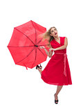 Beautiful woman wearing red dress holding umbrella