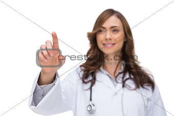 Female doctor touching something