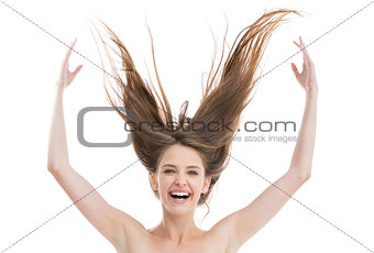 Laughing pretty woman throwing her hair up