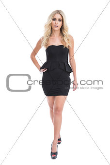 Attractive blonde girl in classy black dress posing