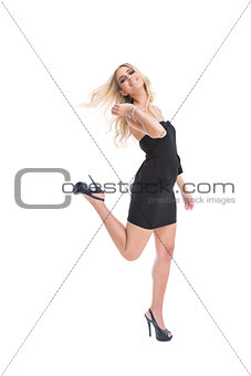 Blonde woman wearing black dress posing