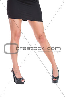 Woman in high heels standing