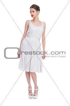 Beautiful woman in white dress posing