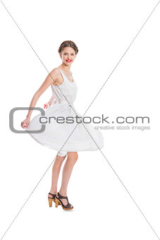 Happy pretty woman in white summer dress posing