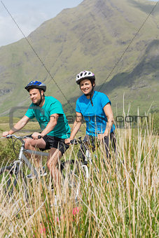 Fit couple cycling together