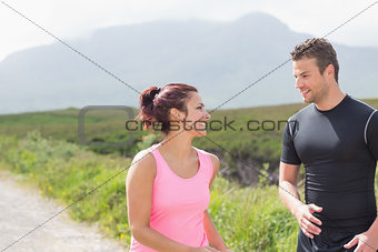 Athletic couple taking a break from jogging