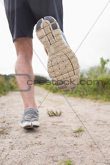 Mans legs jogging rear view