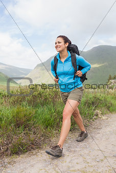Female hiker with backpack walking