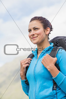 Smiling female hiker with backpack