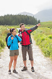 Hikers with backpacks standing on country trail
